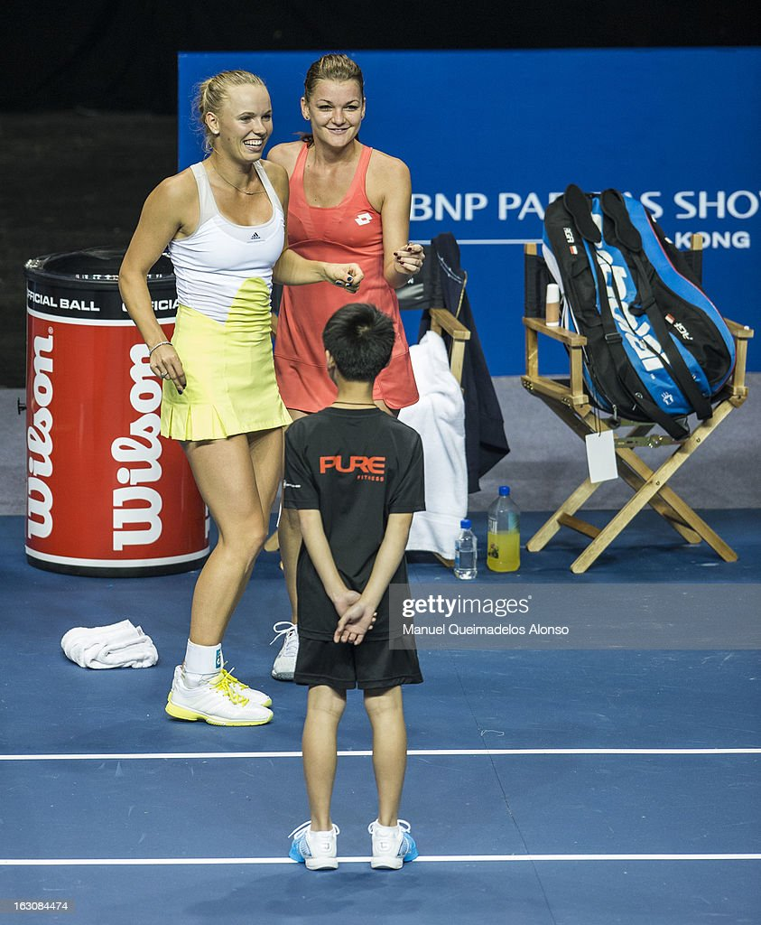 <a gi-track='captionPersonalityLinkClicked' href=/galleries/search?phrase=Caroline+Wozniacki&family=editorial&specificpeople=740679 ng-click='$event.stopPropagation()'>Caroline Wozniacki</a> of Denmark and <a gi-track='captionPersonalityLinkClicked' href=/galleries/search?phrase=Agnieszka+Radwanska&family=editorial&specificpeople=579516 ng-click='$event.stopPropagation()'>Agnieszka Radwanska</a> dance in a break of their match as part of the Hong Kong Showdown at the Asia-World Expo on March 4, 2013 in Hong Kong, China.