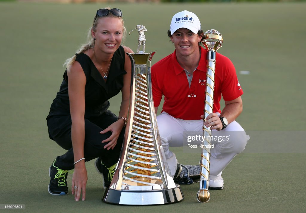Caroline Wozniacki of Denmark and Rory McIlroy of Northern Ireland with the DP World Tour Championship and The Race to Dubai trophy on the 18th green during the final roung of the DP World Tour Championship on the Earth Course at Jumeirah Golf Estates on November 25, 2012 in Dubai, United Arab Emirates.
