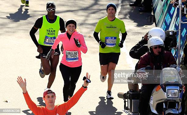 Caroline Wozniacki of Denmark approaches the finish line during the Pro Women's division during the 2014 TCS New York City Marathon on November 2...