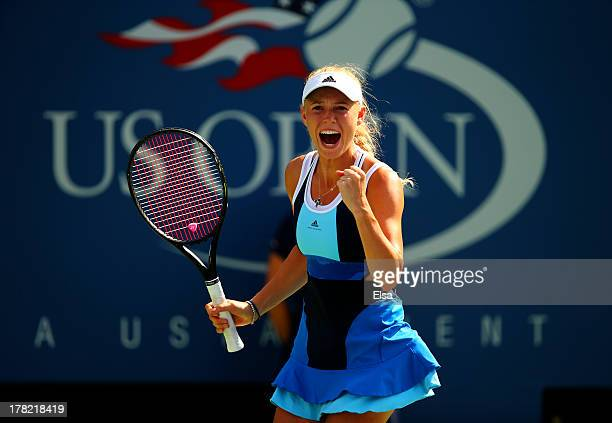 Caroline Wozniacki of Denmark celebrates a point during her women's singles first round match against YingYing Duan of China on Day Two of the 2013...