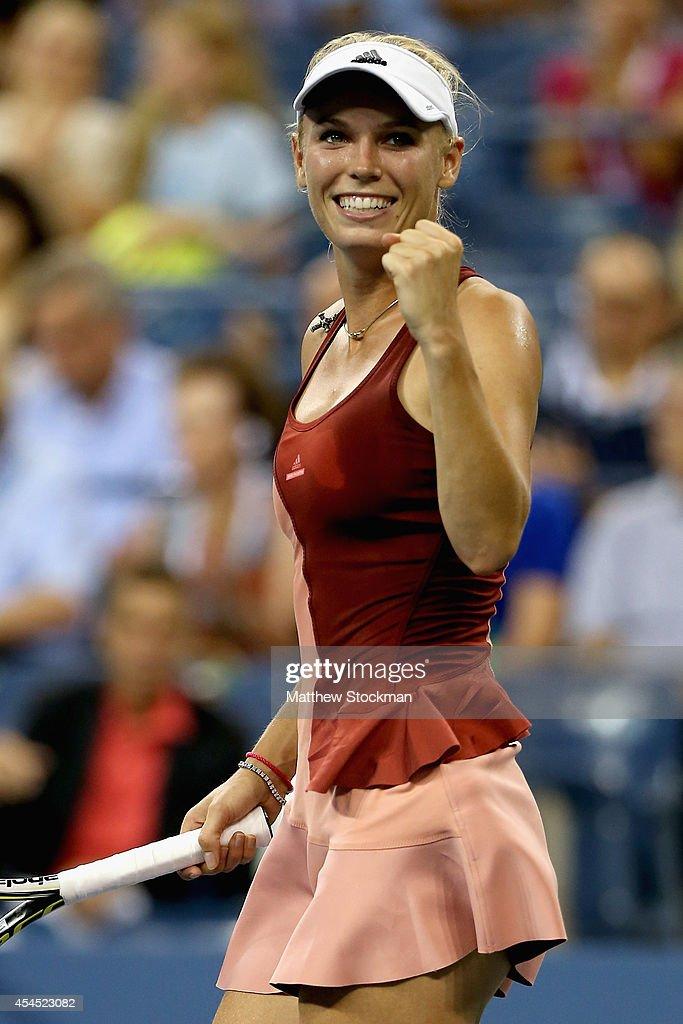 Caroline Wozniacki of Denmark celebrates after defeating Sara Errani of Italy in their women's singles quarterfinal match on Day Nine of the 2014 US...