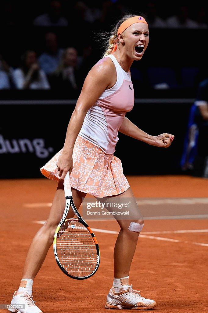 Caroline Wozniacki of Denmark celebrates after her victory in her semi final match against Simona Halep of Romania during Day 6 of the Porsche Tennis...