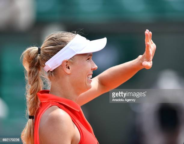 Caroline Wozniacki of Denmark celebrates after she won the match against Svetlana Kuznetsova of Russia in their 4th round match of the French Open...