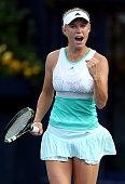 Caroline Wozniacki of Denmark celebrates beating Sorana Cirstea of Romania during day four of the WTA Dubai Duty Free Tennis Championships at the...