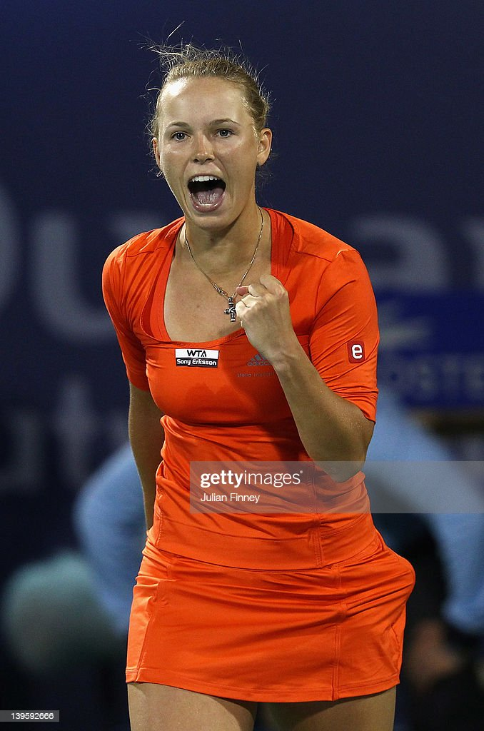 <a gi-track='captionPersonalityLinkClicked' href=/galleries/search?phrase=Caroline+Wozniacki&family=editorial&specificpeople=740679 ng-click='$event.stopPropagation()'>Caroline Wozniacki</a> of Denmark celebrates defeating Ana Ivanovic of Serbia during day four of the WTA Dubai Duty Free Tennis Championship on February 23, 2012 in Dubai, United Arab Emirates.