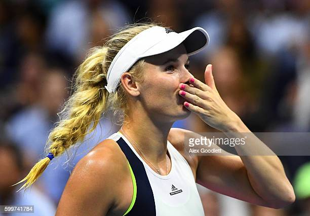 Caroline Wozniacki of Denmark celebrates defeating Anastasija Sevastova of Lativa during their Women's Singles Quarterfinals match on Day Nine of the...