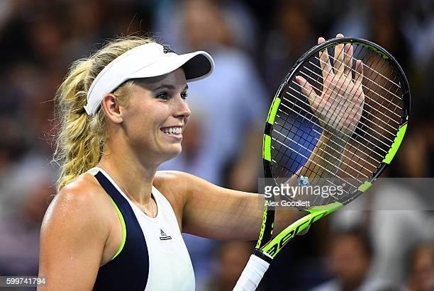 Caroline Wozniacki of Denmark celebrates defeating Anastasija Sevastova of Lativa during their Women's Singles Quarterfinals match on Day Nine of the...