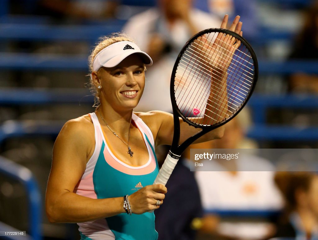<a gi-track='captionPersonalityLinkClicked' href=/galleries/search?phrase=Caroline+Wozniacki&family=editorial&specificpeople=740679 ng-click='$event.stopPropagation()'>Caroline Wozniacki</a> of Denmark celebrates her match win over Sloane Stephens of the USA during Day Five of the New Haven Open at Yale at the Connecticut Tennis Center on August 22, 2013 in New Haven, Connecticut.