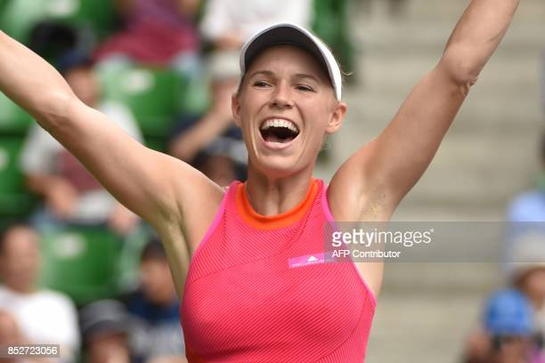 Caroline Wozniacki of Denmark celebrates her victory against Anastasia Pavlyuchenkova of Russia during the women's singles final at the Pan Pacific...