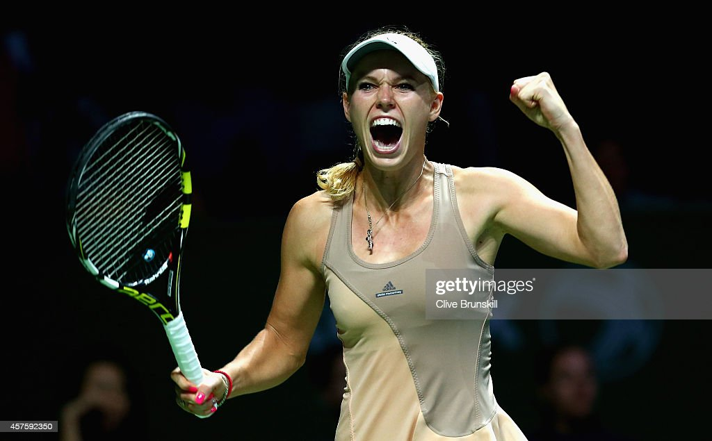 <a gi-track='captionPersonalityLinkClicked' href=/galleries/search?phrase=Caroline+Wozniacki&family=editorial&specificpeople=740679 ng-click='$event.stopPropagation()'>Caroline Wozniacki</a> of Denmark celebrates match point against Maria Sharapova of Russia in their round robin match during the BNP Paribas WTA Finals at Singapore Sports Hub on October 21, 2014 in Singapore.