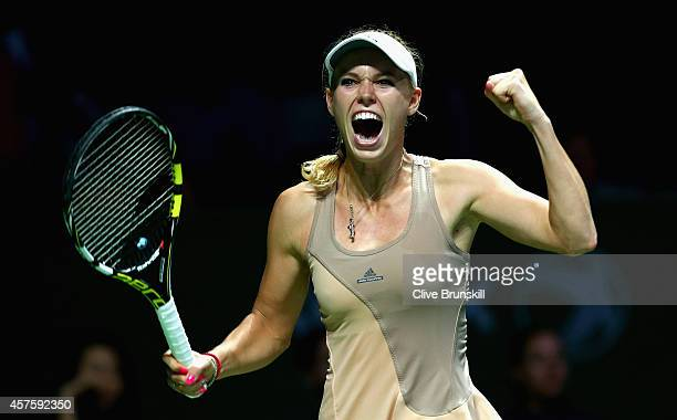 Caroline Wozniacki of Denmark celebrates match point against Maria Sharapova of Russia in their round robin match during the BNP Paribas WTA Finals...