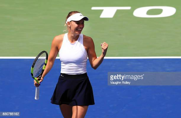 Caroline Wozniacki of Denmark celebrates victory against Sloane Stephens of the United States during a semifinal match on Day 8 of the Rogers Cup at...
