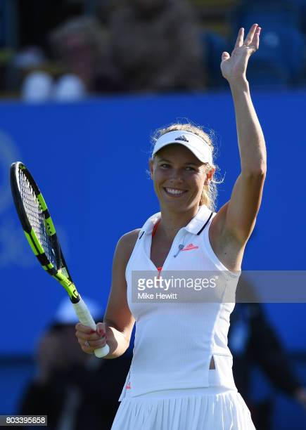 Caroline Wozniacki of Denmark celebrates victory during the ladies singles quarter final match against Simona Halep of Romania on day five of the...