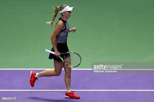 Caroline Wozniacki of Denmark celebrates victory in her singles match against Elina Svitolina of Ukraine during day 2 of the BNP Paribas WTA Finals...