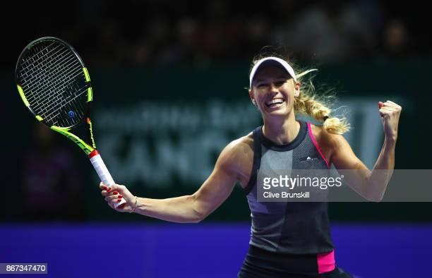 Caroline Wozniacki of Denmark celebrates victory in her singles semi final match against Karolina Pliskova of Czech Republic during day 7 of the BNP...