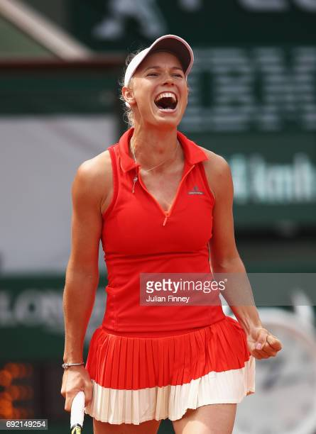 Caroline Wozniacki of Denmark celebrates victory in her women's singles fourth round match against Svetlana Kuznetsova of Russia during day eight of...