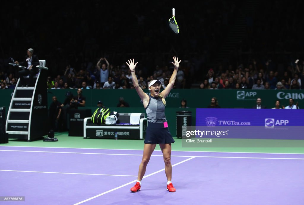 Caroline Wozniacki of Denmark celebrates victory in the Singles Final against Venus Williams of the United States during day 8 of the BNP Paribas WTA Finals Singapore presented by SC Global at Singapore Sports Hub on October 29, 2017 in Singapore.