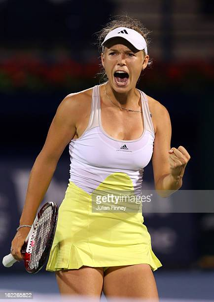 Caroline Wozniacki of Denmark celebrates winning a game against Marion Bartoli of France during day four of the WTA Dubai Duty Free Tennis...