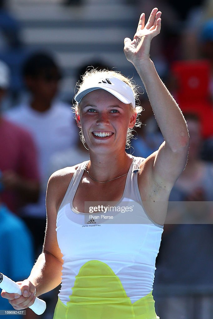 <a gi-track='captionPersonalityLinkClicked' href=/galleries/search?phrase=Caroline+Wozniacki&family=editorial&specificpeople=740679 ng-click='$event.stopPropagation()'>Caroline Wozniacki</a> of Denmark celebrates winning her second round match against Donna Vekic of Croatia during day four of the 2013 Australian Open at Melbourne Park on January 17, 2013 in Melbourne, Australia.