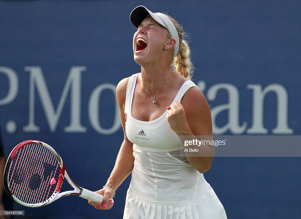 <a gi-track='captionPersonalityLinkClicked' href=/galleries/search?phrase=Caroline+Wozniacki&family=editorial&specificpeople=740679 ng-click='$event.stopPropagation()'>Caroline Wozniacki</a> of Denmark celebrates winning match point against Andrea Petkovic of Germany during Day Eleven of the 2011 US Open at the USTA Billie Jean King National Tennis Center on September 8, 2011 in the Flushing neighborhood of the Queens borough of New York City.