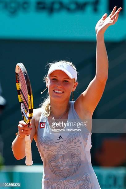 Caroline Wozniacki of Denmark celebrates winning the women's singles first round match between Caroline Wozniacki of Denmark and Alla Kudryavtseva of...