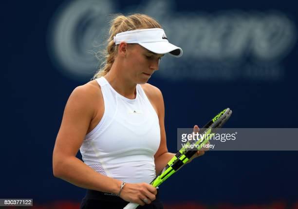 Caroline Wozniacki of Denmark checks her racket against Karolina Pliskova of Czech Republic during Day 7 of the Rogers Cup at Aviva Centre on August...