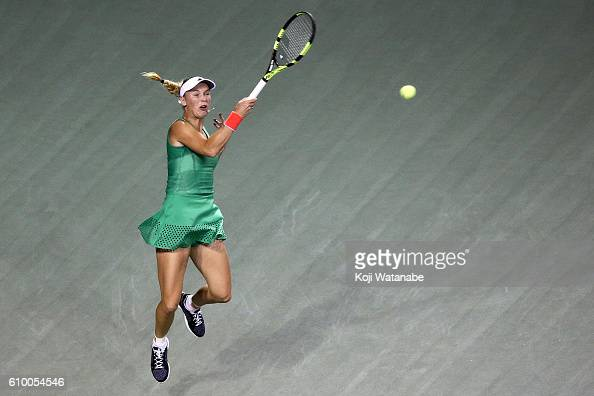 Caroline Wozniacki of Denmark competes against Agnieszka Radwanska of Poland during women's singles semifinal match day 6 of the Toray Pan Pacific...