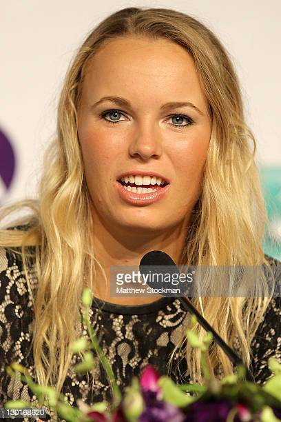Caroline Wozniacki of Denmark fields questions from the media at the All Access Hour press conference before the TEB BNP Paribas WTA Championships at...