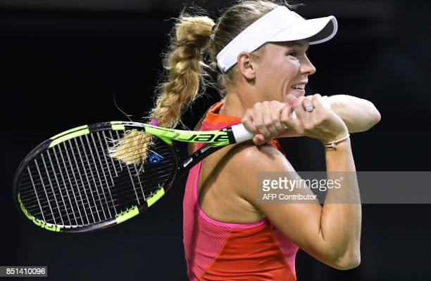 Caroline Wozniacki of Denmark follows her return shot to Dominika Cibulkova of Slovakia during their women's singles quarterfinal match at the Pan...