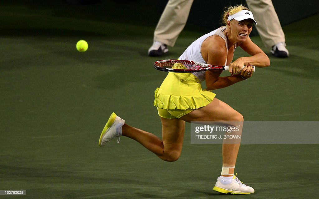 Caroline Wozniacki of Denmark hits a backhand return against Angelique Kerber of Germany on March 15, 2013 in Indian Wells, California, during their semirfinal match at the BNP Paribas Open. AFP PHOTO/Frederic J. BROWN