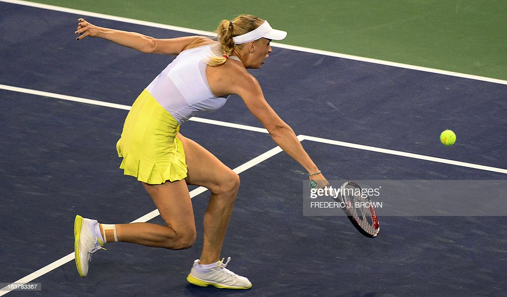 Caroline Wozniacki of Denmark hits a backhand return against Angelique Kerber of Germany on March 15, 2013 in Indian Wells, California, in their semirfinal match at the BNP Paribas Open. AFP PHOTO/Frederic J. BROWN