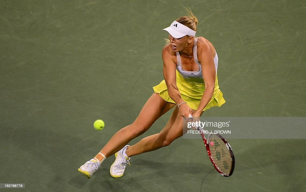 Caroline Wozniacki of Denmark hits a backhand return against Angelique Kerber of Germany on March 15, 2013 in Indian Wells, California, in their semifinal match at the BNP Paribas Open. AFP PHOTO/Frederic J. BROWN
