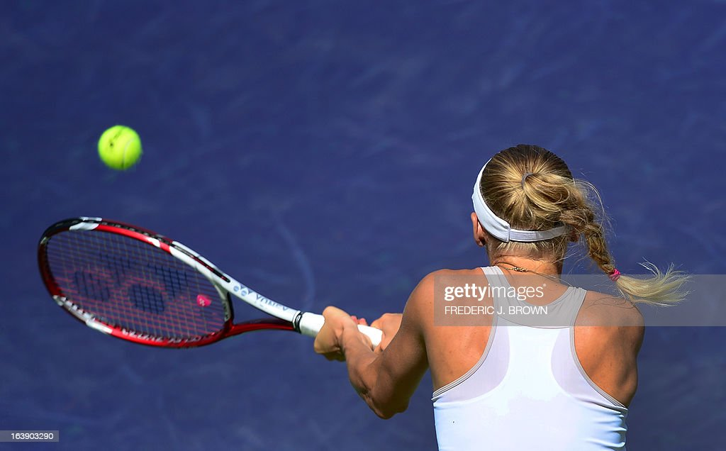 Caroline Wozniacki of Denmark hits a backhand return against Maria Sharapova of Russia on March 17, 2013 in Indian Wells, California, in the women's tennis final at the BNP Paribas Open. AFP PHOTO/Frederic J. BROWN