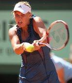 Caroline Wozniacki of Denmark hits a backhand return during the women's singles round two match between Caroline Wozniacki of Denmark and Aleksandra...