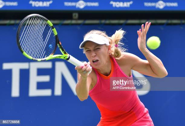 Caroline Wozniacki of Denmark hits a return against Anastasia Pavlyuchenkova of Russia during the women's singles final at the Pan Pacific Open...