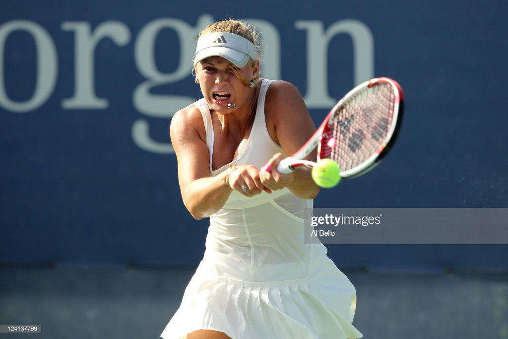 <a gi-track='captionPersonalityLinkClicked' href=/galleries/search?phrase=Caroline+Wozniacki&family=editorial&specificpeople=740679 ng-click='$event.stopPropagation()'>Caroline Wozniacki</a> of Denmark hits a return against Andrea Petkovic of Germany during Day Eleven of the 2011 US Open at the USTA Billie Jean King National Tennis Center on September 8, 2011 in the Flushing neighborhood of the Queens borough of New York City.
