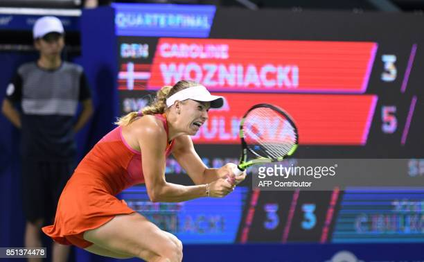 Caroline Wozniacki of Denmark hits a return against Dominika Cibulkova of Slovakia during their women's singles quarterfinal match at the Pan Pacific...