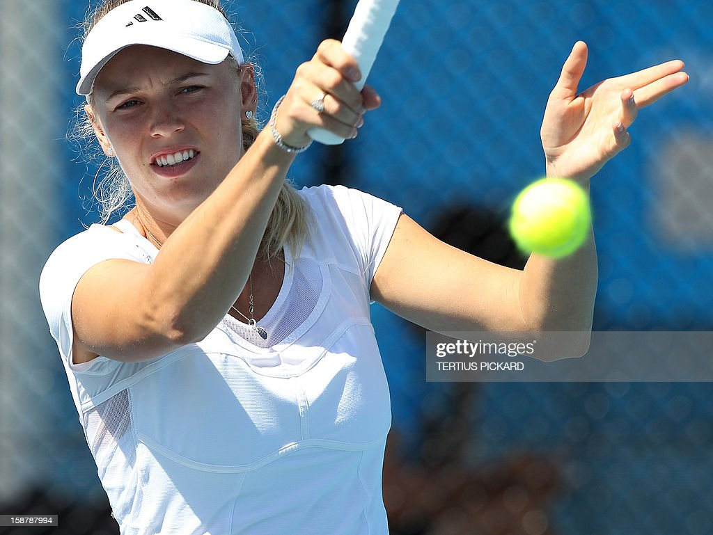 Caroline Wozniacki of Denmark hits a return during a training session in Brisbane on December 29, 2012, before the upcoming Brisbane International. Top international men's and women's players are using the Brisbane International as a build-up to the Australian Open, which runs from January 14 to 27. AFP PHOTO/Tertius PICKARD USE