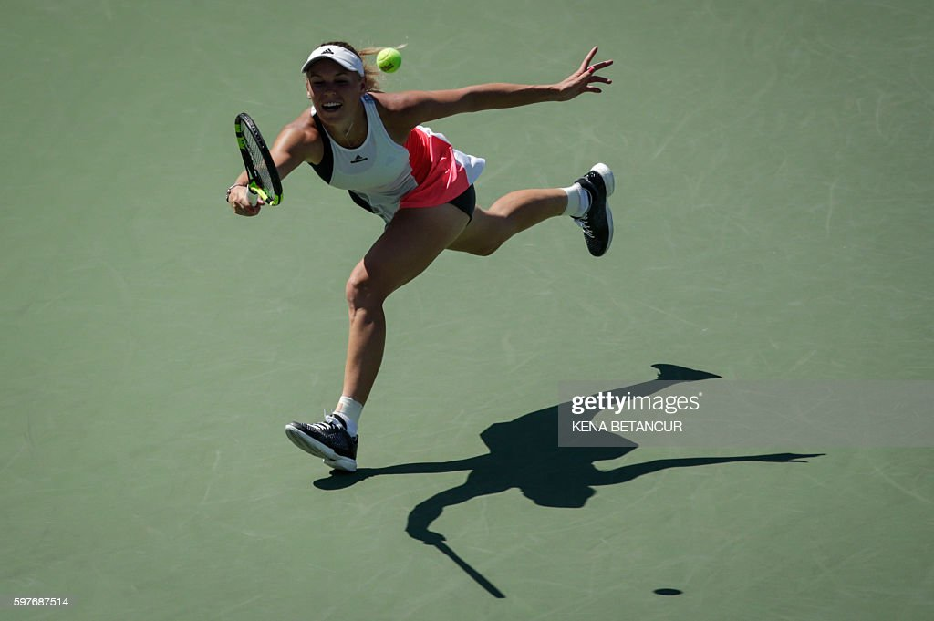 Caroline Wozniacki of Denmark hits a return to Taylor Townsend of the US during their 2016 US Open Women's Singles Round 1 match at the USTA Billie...
