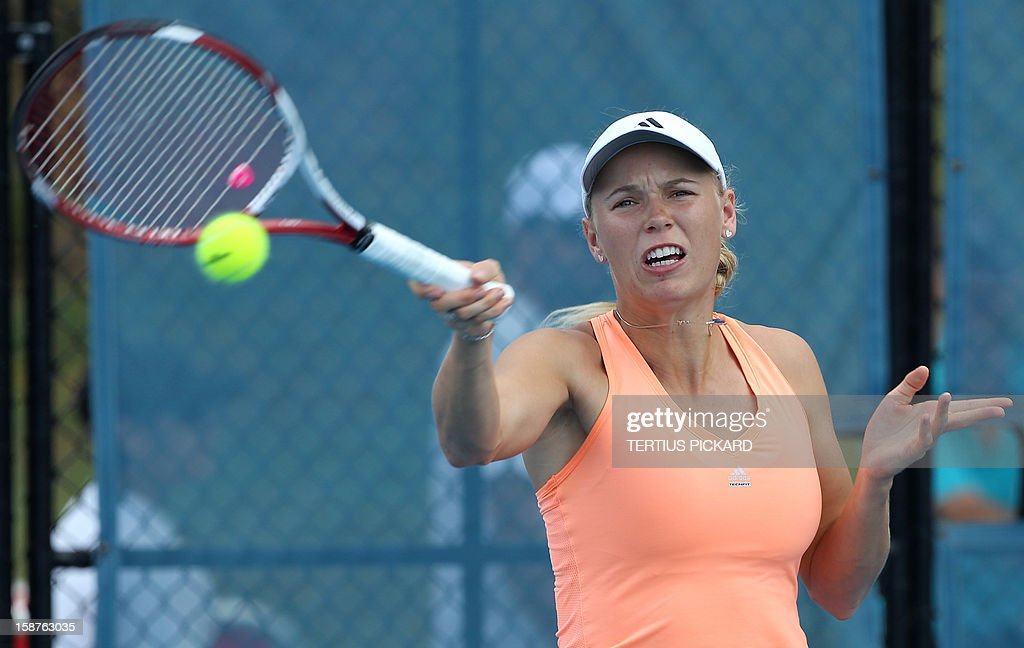 Caroline Wozniacki of Denmark hits a shot during her first training session in Brisbane on December 28, 2012, for the upcoming Brisbane International tennis tournament. The top international men's and women's players are using the Brisbane International as a build-up to the Australian Open, which runs from January 14 to 27. AFP PHOTO / Tertius PICKARD USE