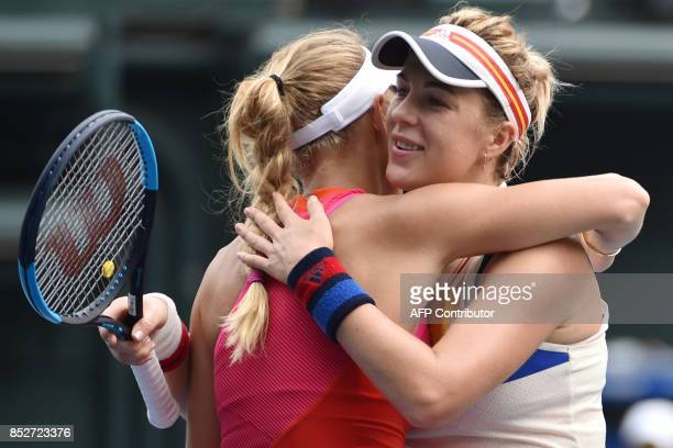 Caroline Wozniacki of Denmark hugs Anastasia Pavlyuchenkova of Russia after her victory during the women's singles final at the Pan Pacific Open...