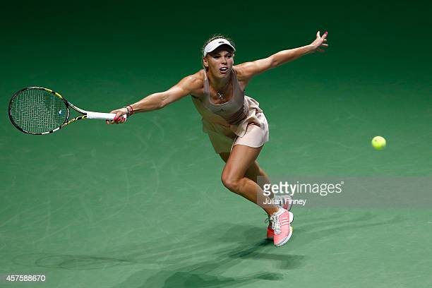 Caroline Wozniacki of Denmark in action against Maria Sharapova of Russia during day two of the BNP Paribas WTA Finals tennis at the Singapore Sports...