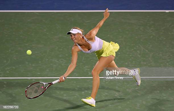 Caroline Wozniacki of Denmark in action against Marion Bartoli of France during day four of the WTA Dubai Duty Free Tennis Championship on February...