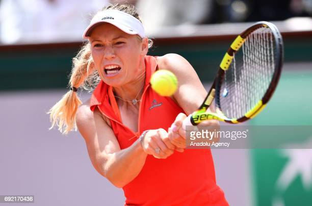 Caroline Wozniacki of Denmark in action against Svetlana Kuznetsova of Russia in their 4th round match of the French Open tennis tournament at the...