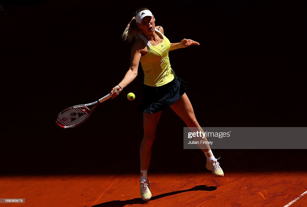 <a gi-track='captionPersonalityLinkClicked' href=/galleries/search?phrase=Caroline+Wozniacki&family=editorial&specificpeople=740679 ng-click='$event.stopPropagation()'>Caroline Wozniacki</a> of Denmark in action against Yaroslava Shvedova of Kazakhstan during day two of the Mutua Madrid Open tennis tournament at the Caja Magica on May 5, 2013 in Madrid, Spain.