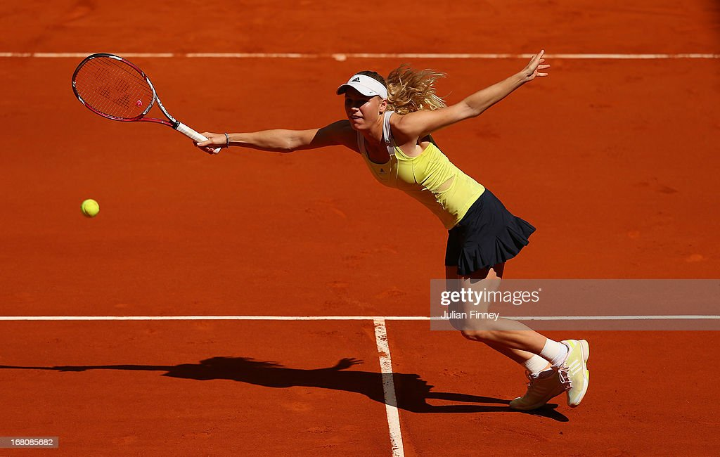 Caroline Wozniacki of Denmark in action against Yaroslava Shvedova of Kazakhstan during day two of the Mutua Madrid Open tennis tournament at the Caja Magica on May 5, 2013 in Madrid, Spain.