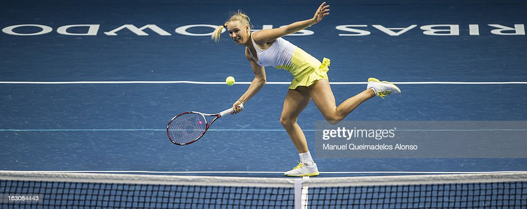 <a gi-track='captionPersonalityLinkClicked' href=/galleries/search?phrase=Caroline+Wozniacki&family=editorial&specificpeople=740679 ng-click='$event.stopPropagation()'>Caroline Wozniacki</a> of Denmark in action during her match against Agnieszka Radwanska as part of the Hong Kong Showdown at the Asia-World Expo on March 4, 2013 in Hong Kong, China.