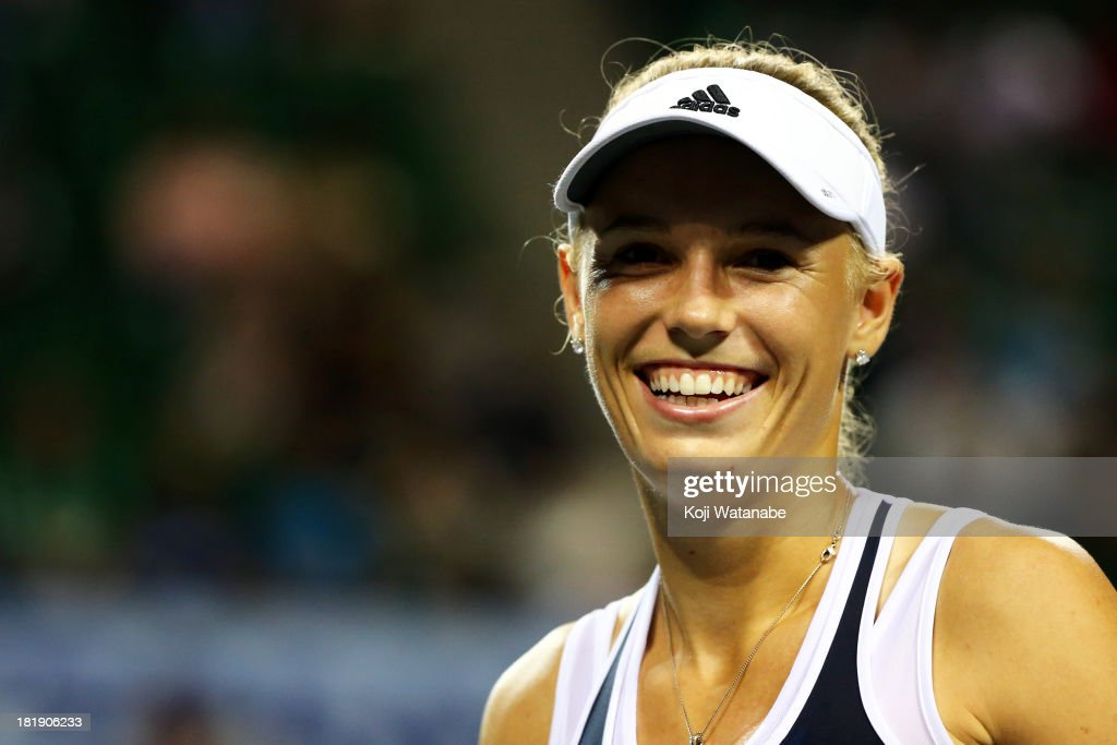 <a gi-track='captionPersonalityLinkClicked' href=/galleries/search?phrase=Caroline+Wozniacki&family=editorial&specificpeople=740679 ng-click='$event.stopPropagation()'>Caroline Wozniacki</a> of Denmark in action during her women's singles quarter final match against Lucie Safarova of Czech Republic during day five of the Toray Pan Pacific Open at Ariake Colosseum on September 26, 2013 in Tokyo, Japan.