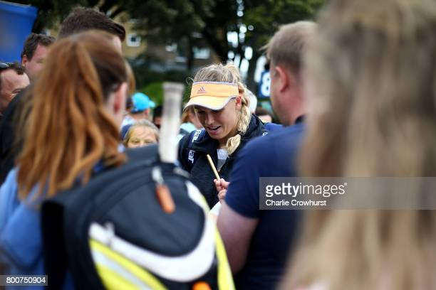 Caroline Wozniacki of Denmark is mobbed by fans as she leaves the practice courts during day one of the Aegon International Eastbourne on June 24...