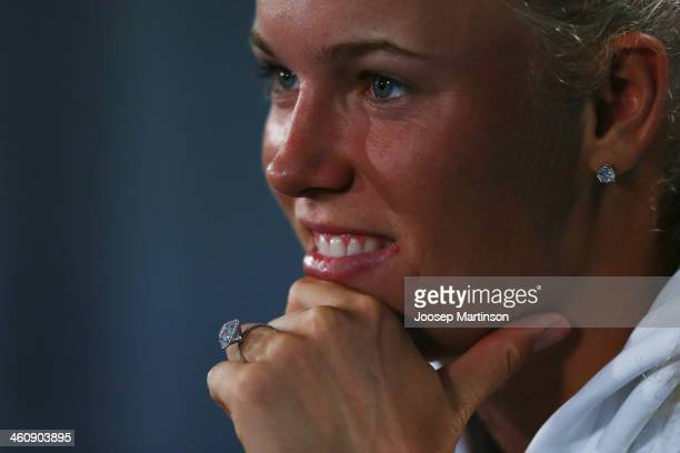 Caroline Wozniacki of Denmark is seen wearing her engagement ring from Rory McIlroy as she speaks to media during day two of the Sydney International...